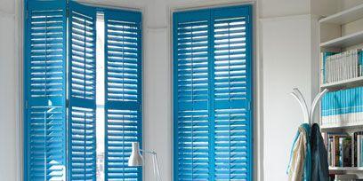 Blue, Room, Interior design, Floor, Shelf, Bookcase, Furniture, Flooring, Wall, Window covering,