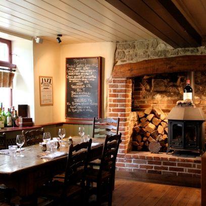 Wood, Property, Room, Hearth, Hardwood, Wall, Table, Interior design, Brick, Ceiling,