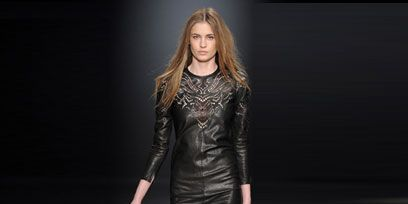 Clothing, Hair, Mouth, Fashion show, Brown, Hairstyle, Sleeve, Human leg, Human body, Shoulder,