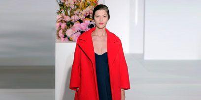 Sleeve, Shoulder, Joint, Fashion, One-piece garment, Fashion model, Street fashion, High heels, Maroon, Day dress,