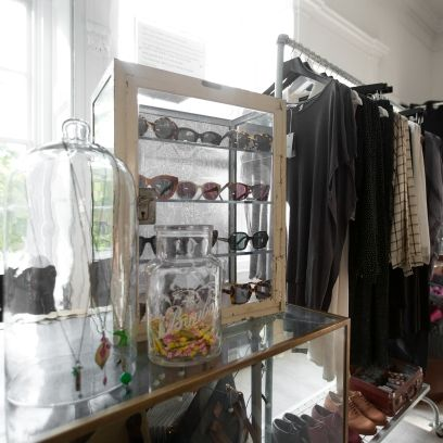 Glass, Clothes hanger, Retail, Transparent material, Shelving, Dishware, Shelf, Collection, Boutique, Outlet store,