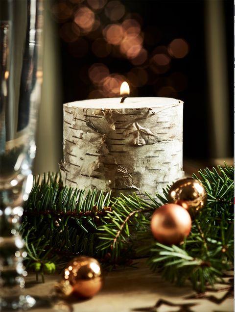 Event, Christmas decoration, Christmas ornament, Holiday, Interior design, Christmas, Candle, Holiday ornament, Christmas tree, Evergreen,