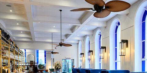 Lighting, Interior design, Ceiling, Furniture, Interior design, Mechanical fan, Ceiling fan, Hall, Light fixture, Shelf,