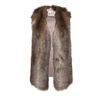 Brown, Textile, Fur clothing, Natural material, Fur, Beige, Woolen, Wool, Animal product, Polar fleece,