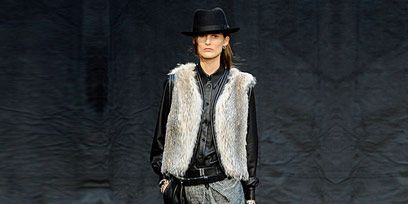 Sleeve, Human body, Hat, Shoulder, Fashion show, Joint, Outerwear, Runway, Style, Fashion model,