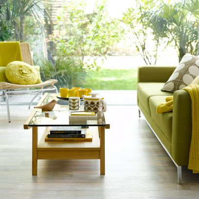 Yellow, Room, Table, Floor, Furniture, Couch, Flooring, Interior design, Coffee table, Living room,