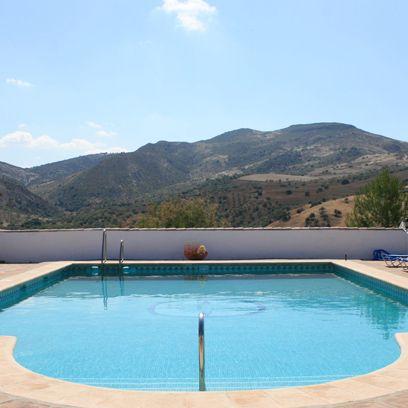 Fluid, Swimming pool, Mountainous landforms, Aqua, Hill, Liquid, Mountain range, Azure, Turquoise, Composite material,