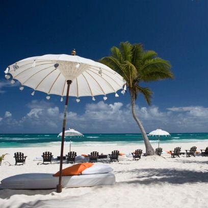 Body of water, Coastal and oceanic landforms, Shore, Ocean, Umbrella, Summer, Tourism, Beach, Sea, Coast,