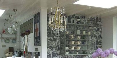Room, Floor, Interior design, Flooring, Light fixture, Ceiling, Table, Ceiling fixture, Chandelier, Furniture,
