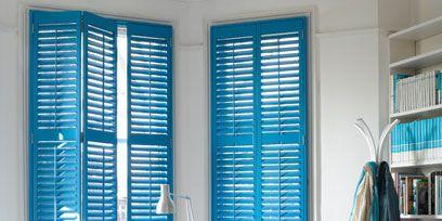 Blue, Room, Interior design, Floor, Flooring, Shelf, Window covering, Wall, Teal, Bookcase,