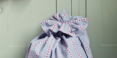 Floor, Pattern, Flooring, Tile, Party supply, Ribbon, Design, Embellishment, Party favor, Pattern,
