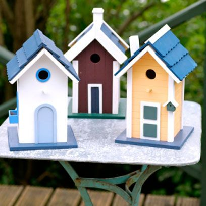 Wood, Birdhouse, Real estate, Birdhouse, Pet supply, Scale model, Roof,