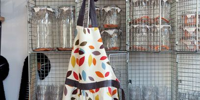Apron, Home accessories, Day dress, One-piece garment, Pattern, Mesh, Pet supply, Cage, Cone,