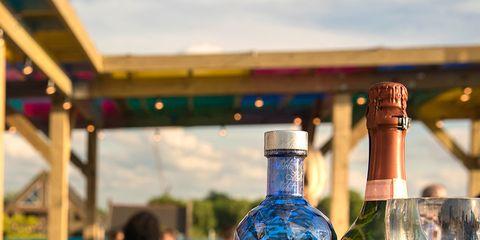 Water, Drink, Blue, Bottle, Alcohol, Glass bottle, Liqueur, Glass, Alcoholic beverage, Distilled beverage,