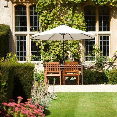 Plant, Window, Shrub, Garden, Outdoor table, Groundcover, Lawn, Yard, Umbrella, Hedge,