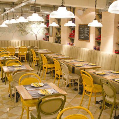 Lighting, Yellow, Furniture, Interior design, Light fixture, Table, Restaurant, Amber, Ceiling, Function hall,