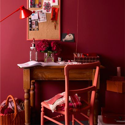 Room, Interior design, Furniture, Table, Interior design, Picture frame, Maroon, Coquelicot, Houseplant, Lamp,