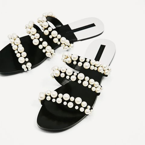 Footwear, Shoe, Flip-flops, Font, Sandal, Fashion accessory, Pearl, Leg, Wedge, Black-and-white,