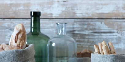 Fluid, Glass, Bottle, Drinkware, Glass bottle, Serveware, Home accessories, Transparent material, Still life photography, Artifact,