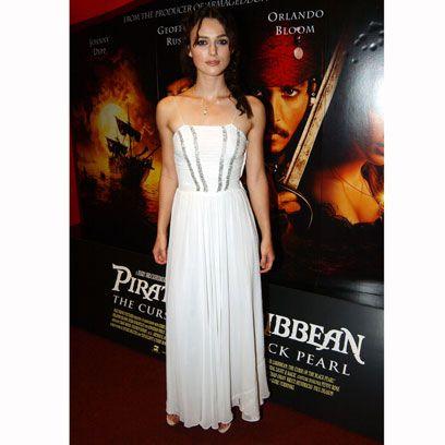 Clothing, Dress, Musical instrument, Formal wear, Amber, Waist, Strapless dress, Flooring, Gown, Beauty,