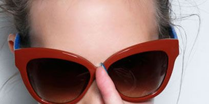 Eyewear, Glasses, Vision care, Lip, Sunglasses, Collar, Goggles, Personal protective equipment, Style, Fashion accessory,