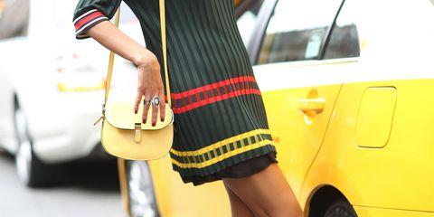 Clothing, Tire, Wheel, Leg, Automotive design, Yellow, Vehicle, Human leg, Land vehicle, Automotive tire,