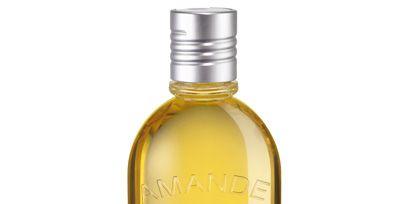 Liquid, Fluid, Product, Yellow, Bottle, Bottle cap, Drink, Alcohol, Alcoholic beverage, Distilled beverage,