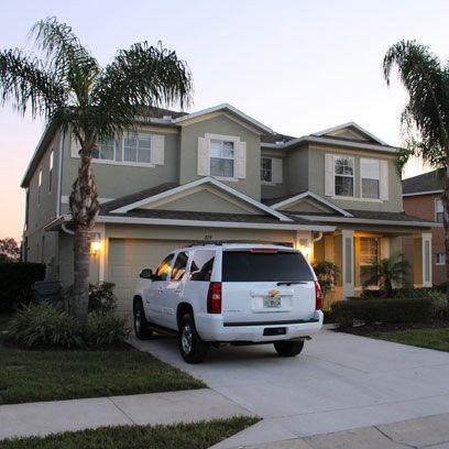 Automotive tail & brake light, Window, Vehicle, Land vehicle, Automotive parking light, Property, Residential area, Neighbourhood, Home, House,