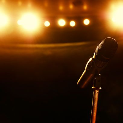 Microphone, Microphone stand, Audio equipment, Light, Sky, Backlighting, Amber, Technology, Performance, Lens flare,