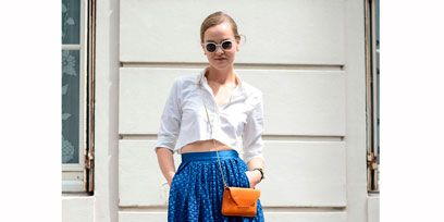 Clothing, Blue, Shoulder, Textile, Joint, Fashion accessory, Sunglasses, Style, Bag, Street fashion,