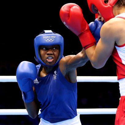 Boxing glove, Sport venue, Nose, Sports uniform, Boxing, Blue, Sports gear, Boxing equipment, Sports equipment, Glove,