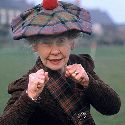 Finger, Plaid, Pattern, Tartan, Textile, Hand, Headgear, Fashion accessory, Gesture, Thumb,