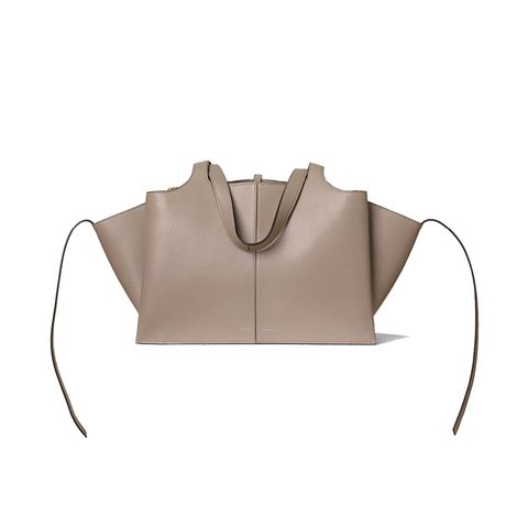 Brown, Beige, Shoulder, Leather, Outerwear, Neck, Personal protective equipment, Fashion accessory,