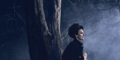 Darkness, Trunk, Blackboard, Overcoat, Fictional character, Painting,