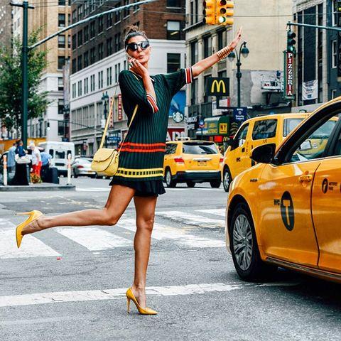 Eyewear, Vision care, Leg, Land vehicle, Road, Yellow, Human leg, Infrastructure, Street, Sunglasses,