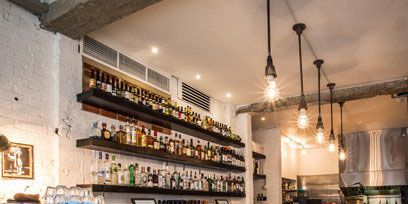 Lighting, Interior design, Light fixture, Shelf, Bottle, Interior design, Drink, Shelving, Collection, Chandelier,