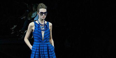 Clothing, Dress, Human leg, Sunglasses, Style, One-piece garment, Jewellery, Fashion model, Electric blue, Fashion accessory,