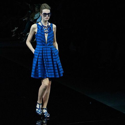 Clothing, Dress, Human leg, Sunglasses, Style, One-piece garment, Jewellery, Fashion model, Electric blue, Fashion accessory,