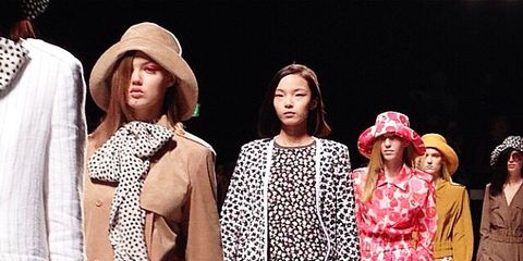 Clothing, Hat, Outerwear, Style, Headgear, Fashion model, Fashion, Street fashion, Costume design, Pattern,