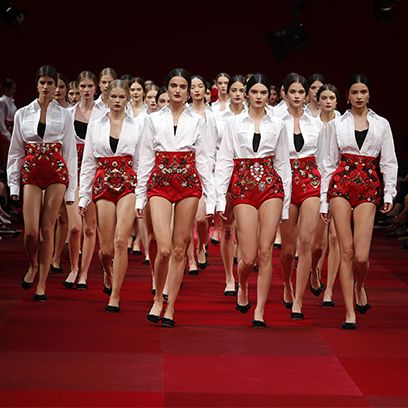 Social group, Red, Uniform, Team, Fashion, Beauty, Competition, Performance art, Crew, Fashion design,