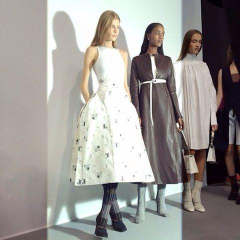Clothing, Footwear, Sleeve, Dress, Style, Formal wear, One-piece garment, Fashion, Pattern, Boot,