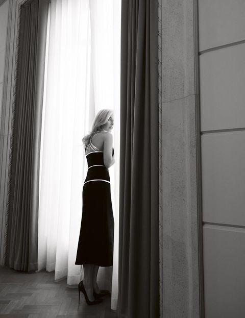 White, Black, Photograph, Black-and-white, Light, Shoulder, Curtain, Standing, Snapshot, Window,