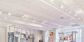 Interior design, Room, Ceiling, Wall, Floor, Interior design, Light fixture, Hall, Bench, Stuffed toy,