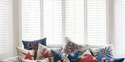 Blue, Interior design, Brown, Room, Living room, Textile, Home, Furniture, White, Cushion,
