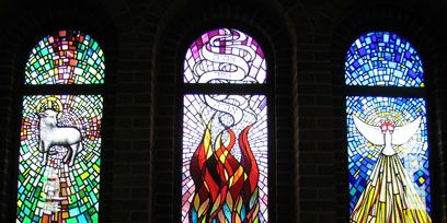 Stained glass, Glass, Interior design, Fixture, Art, Arch, Holy places, Symmetry, Place of worship, Visual arts,