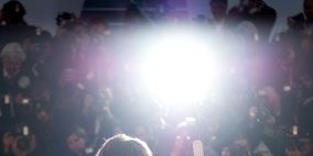People, Event, Crowd, Social group, Photograph, Magenta, Light, Audience, Snapshot, Stage,