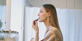 Hairstyle, Sleeve, Plumbing fixture, Interior design, Wall, Interior design, Bathroom sink, Long hair, Blond, Tap,