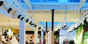 Ceiling, Iron, Handrail, Light fixture, Retail, Column, Commercial building, Shopping mall, Outlet store, Building material,
