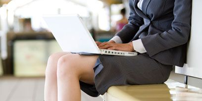 Human leg, Sitting, Suit trousers, Knee, Foot, Bag, Blazer, Street fashion, Portable communications device, Laptop,