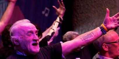Arm, Finger, Cap, Magenta, Gesture, Purple, Celebrating, Wrist, Thumb, Public event,